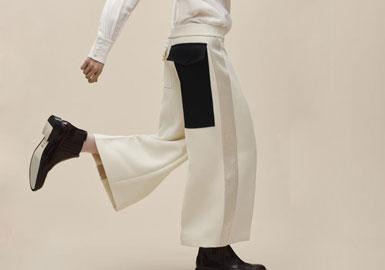 休闲阔腿裤 阔腿裤在2016春夏的流行趋势并没有减退,剪裁宽松,裤长及地。在早秋时节采用硬朗的粗花呢格纹布、灯芯绒和印花棉布,十分新颖,使整体的造型具有一种休闲硬朗气息。