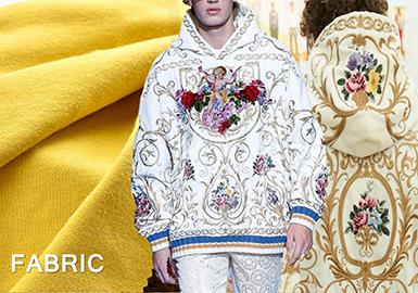 以D & G 为首,2018早秋男装的卫衣款式充满了奢华感,不但出现了很多带有弹力的丝绒针织面料。还会在一些毛圈或抓毛面料上结合宽大的廓形以及图案,来凸显奢华针织风貌。艳丽的雪地红、亮黄色以及暗紫色将是2018早秋男装针织卫衣面料的流行色。