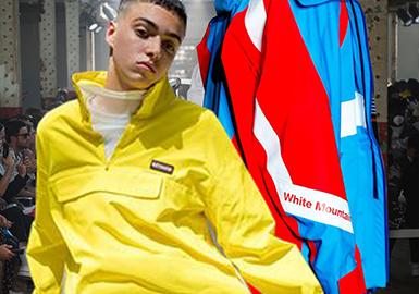 沖鋒衣是男裝中的一個重要品類,尤其是潮牌男裝。在本季2019春夏男裝T臺上設計師們開始玩起色塊拼接以及透明且光澤度高的塑膠材質,產生出色彩的醒目感。除此以外,經典的棉布織物以及迷彩配合多口袋工裝風又再次風靡起來。