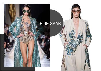 Elie Saab 2019春夏高定系列延續了一貫的華美浪漫風格,無論是高開叉的混紡長裙還是飄逸的雪紡長裙,不規則亮片的點綴如同將星空披在身上一樣,剪裁利落的西式套裝也英氣十足,給整場秀注入了不同的力量。炙熱的紅、清新的藍綠、淡雅的米白等一系列屬于春夏的顏色貫穿整個系列,奢華的香檳色和典雅的寶藍也讓人眼前一亮。反復的刺繡和細膩的褶皺隨處可見,大裙擺的加持提供了選擇的多樣性,立體的花朵更是有趣至極,金屬光輝的配飾鞋履與禮服裙交相輝映。