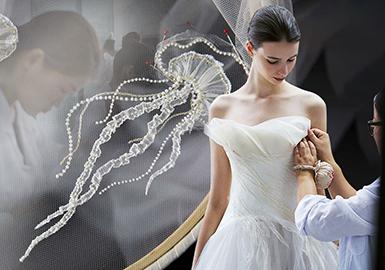 """SHINE MODA和WECOUTURE是中国近些年来婚纱礼服的骄傲和行业标杆,秉持着高要求的设计和高标准的工艺,塑造了一件又一件惊艳众人的礼服。两种品牌在设计上多采取了中国风元素,运用了刺绣或手绘等方式表现设计感,廓形经典简洁,版型绝佳,在简单的廓形上进行点缀已是非常完美,符合中国艺术审美,在""""型""""更有韵味在""""意""""。"""