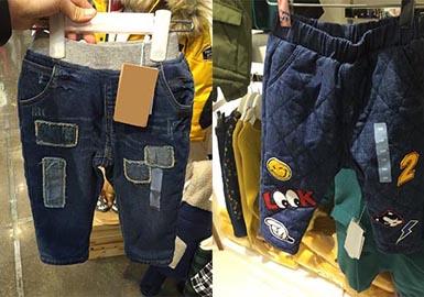 童装牛仔长裤上应用较多的是卡通贴布绣,趣味的绣花和贴布绣结合的应用也非常常见,还有文字和破洞拼接的款式非常新颖耐看。